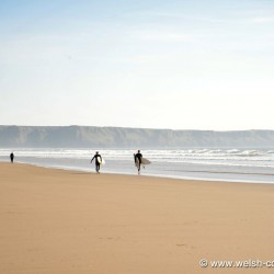 Surfers on Llangenith Beach, Gower Peninsula